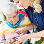 Nurse helping mature adult